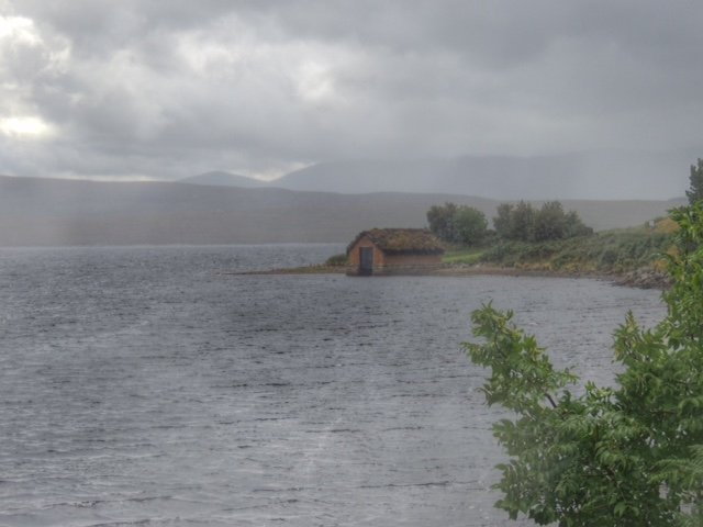 Loch Loyal boathouse with rain rapidly approaching